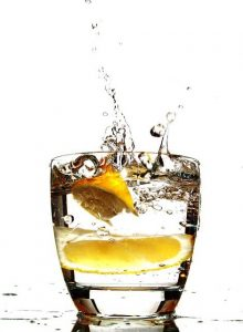glass of water with two lemon wedges