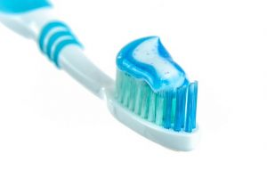 tooth brush with toothpaste on it